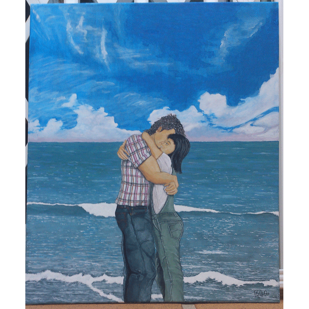Foto obtenida de la pintura realizada con pintura al temple sobre lienzo. Su estilo es impresionista. Aparecen un hombre y una mujer abrazados en la orilla del mar en calma y con cielo casi despejado.